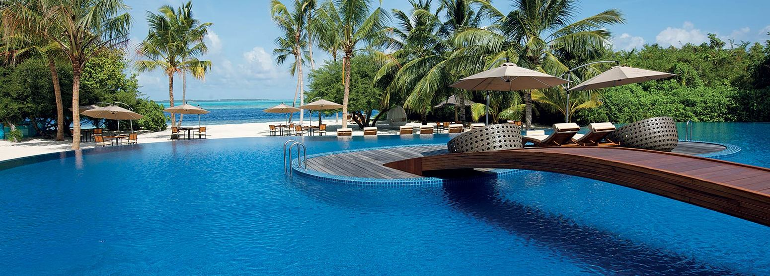 Main Pool with beach and sea background at Hideaway Beach Resort Maldives