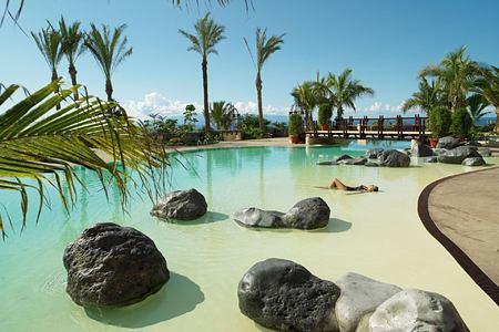 Main pool with palms at Abama Golf and Spa Resort Tenerife