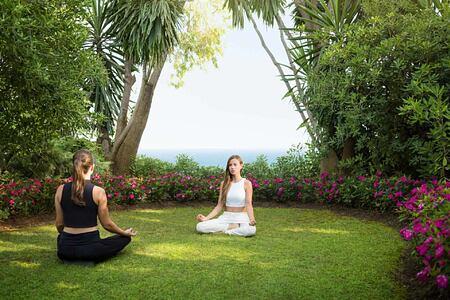 Meditating at Marbella Beach Club Spain