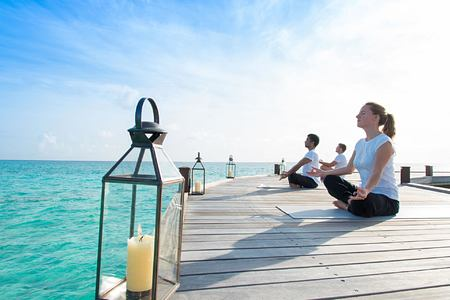 Meditation on the jetty with sea view at Hideaway Beach Resort Maldives