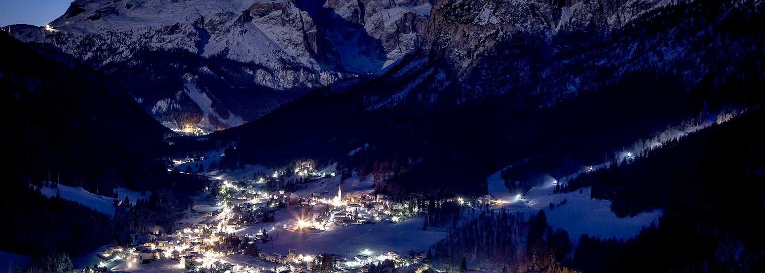 Night view of villlage near Hotel La Majun Italy