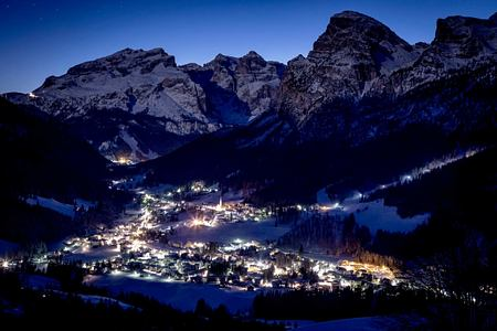 Night view of villlage near Hotel La Majun Italy