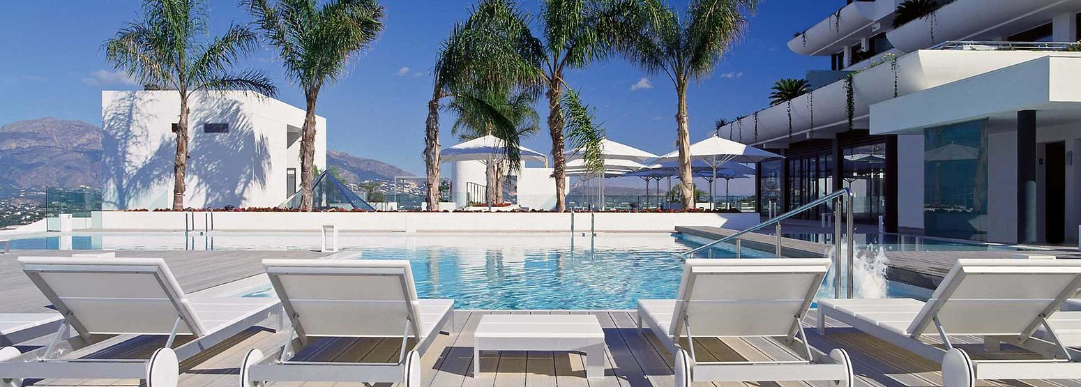 Pool and recliners at SHA Wellness Spain