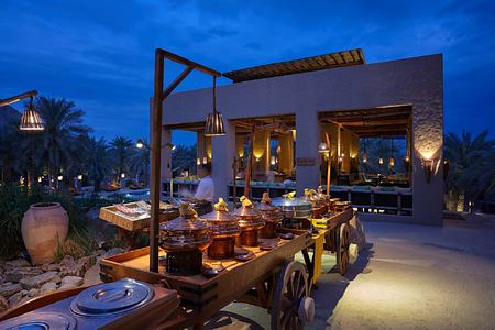 Spice Market exterior buffet at night at Six Senses Zighy Bay Oman