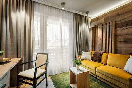 Living area of bedroom suite at Hotel La Majun Italy