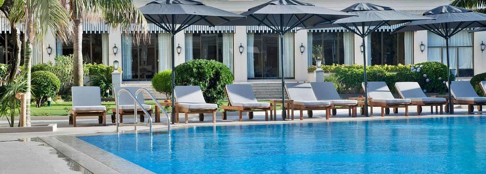 Swimming pool and sun loungers at Palacio Estoril, Portugal