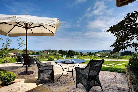 Terrace with coastal views at Hotel Iturregi