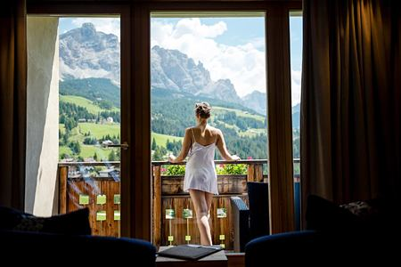 View across summer meadows and mountain at Hotel La Majun Italy