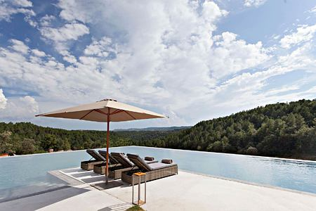 Stunning views across the forest from the pool at la Vella Farga Spain
