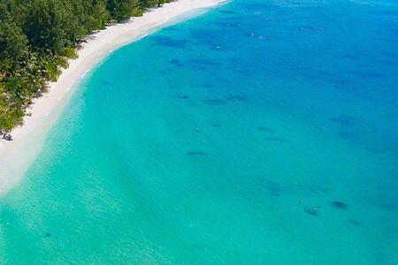 Aerial coastal view of Denis Private Island Seychelles
