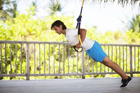 Man using ropes for fitness exercises at Six Senses Douro Valley Portugal