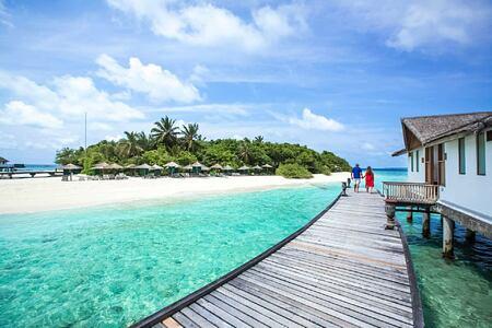 jetty and villa at reethi beach resort maldives