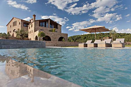 A view across the pool towards la Vella Farga Spain