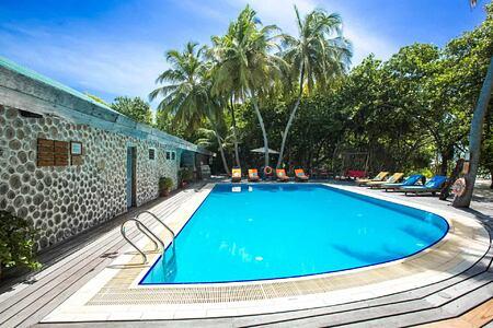swimming pool at reethi beach resort maldives