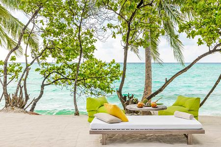 Chairs and BBQ setup at Como Maalifushi Maldives