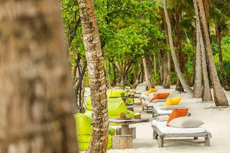 Beach chairs at Como Maalifushi Maldives
