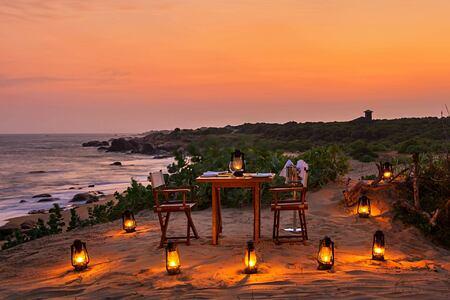 Beach dining at night at Chena Huts Sri Lanka