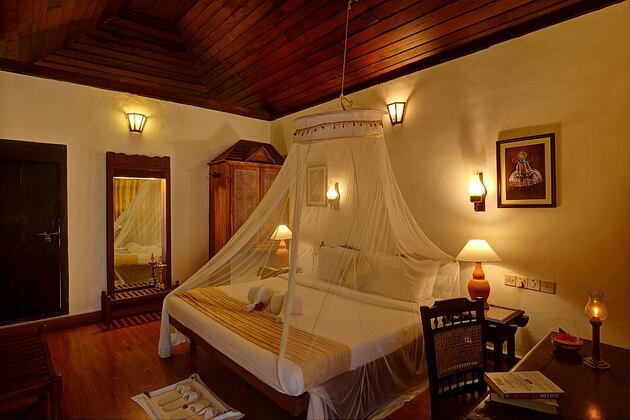 Bedroom with nets at Somatheeram Kerala India