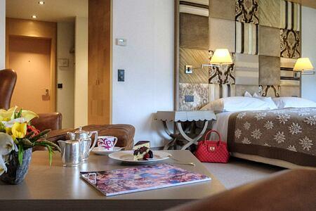 Breakfast in bedroom at Tschuggen Grand Arosa Switzerland