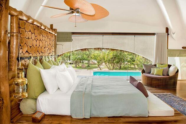 Cabin Bedroom at Chena Huts Sri Lanka