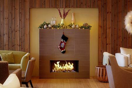 Christmas stocking over fireplace at Icelandair Hotel Iceland