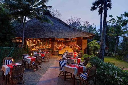 Dining at dusk at Somatheeram Kerala India