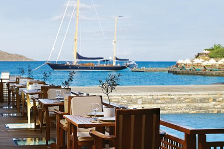 Dining by the sea at Porto Elounda Golf and Spa Crete