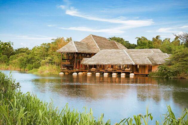 Exterior of main buidlings across river at Vil Uyana Sri Lanka