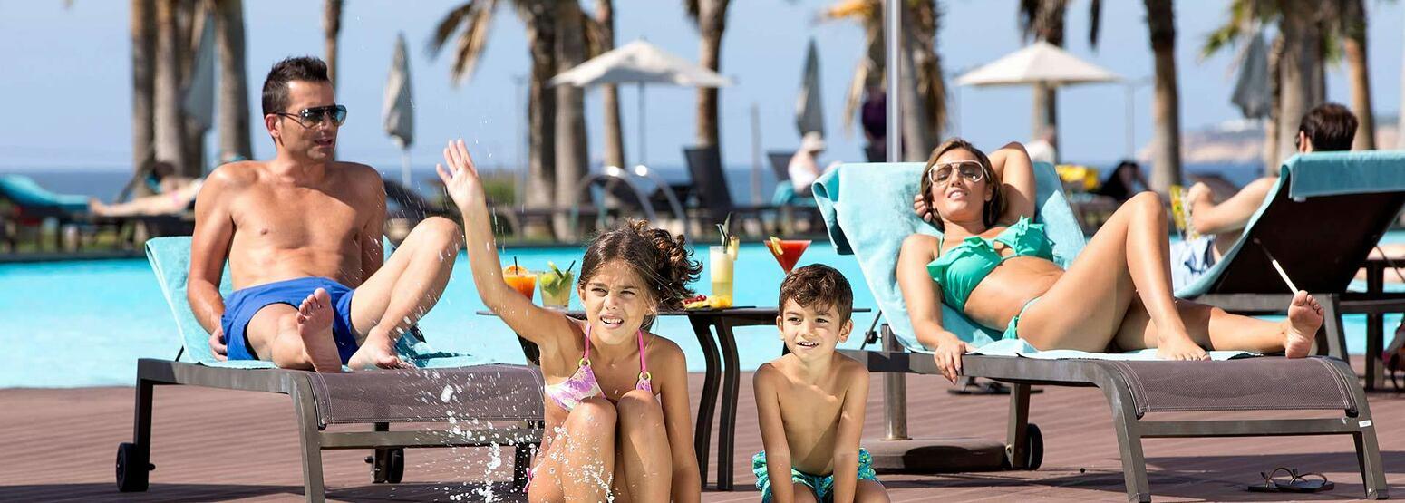 Family having fun at the pool at Vidamar Algarve Portugal
