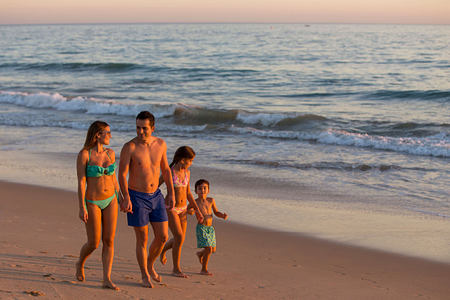 Family having fun on the beach at Vidamar Algarve Portugal