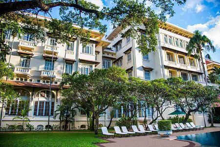 Hotel and Swimming Pool at Raffles Hotel Le Royal Cambodia