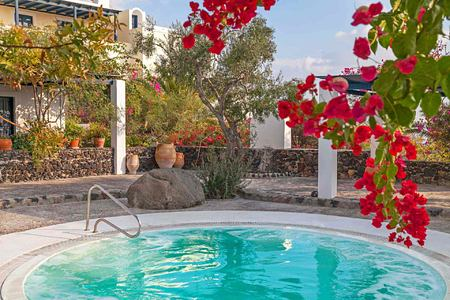 Jacuzzi under the trees at Vedema Santorini Greece