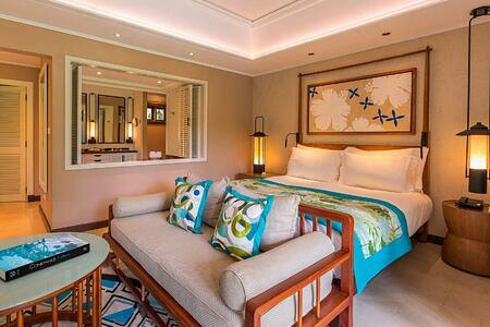 Junior Suite bed at Constance Lemuria Resort Seychelles