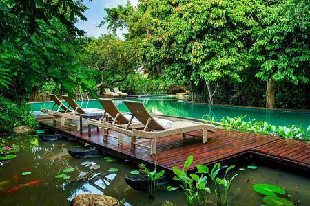 Koi pond and pool at Jungle Beach Sri Lanka