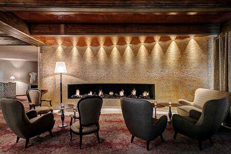 Living room fireplace at Tschuggen Grand Arosa Switzerland