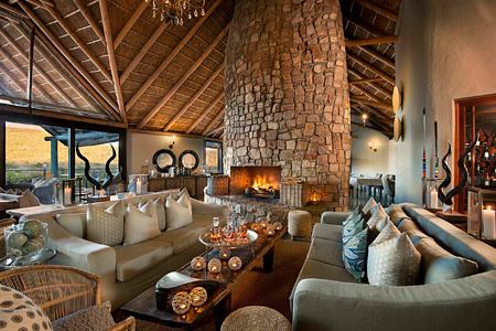 Main lounge with fireplace at Great Fish River Lodge South Africa