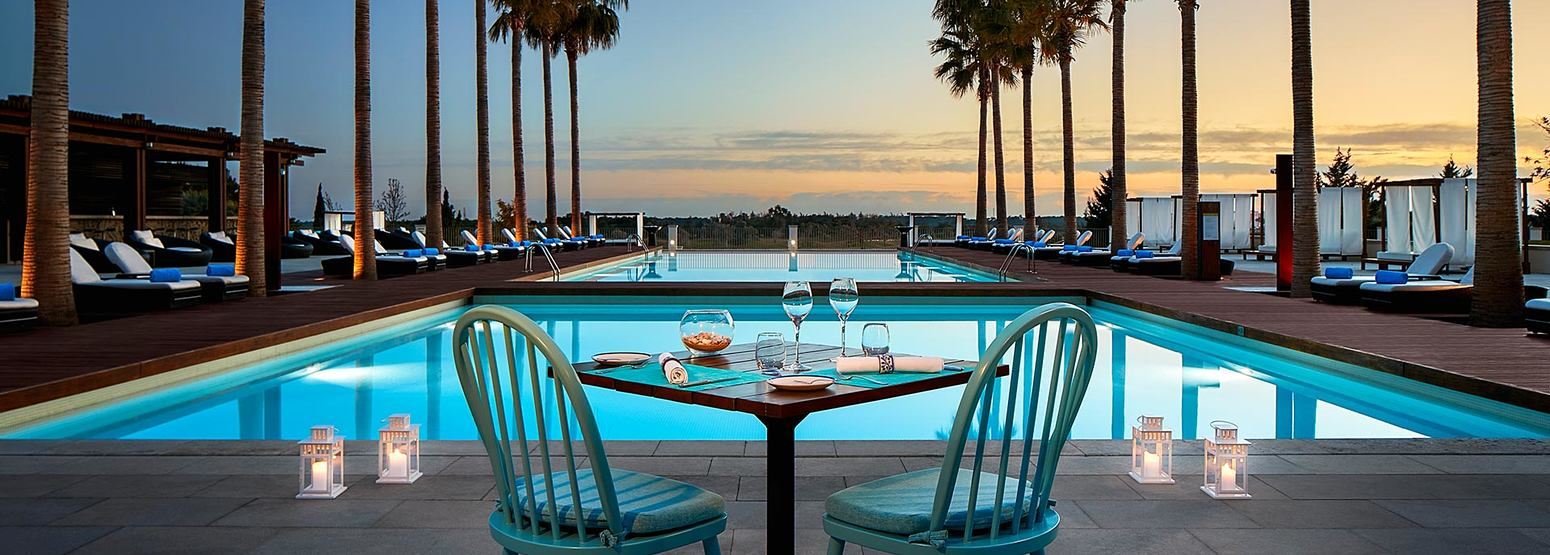 Outdoor dining by the pool at Anantara Vilamoura Algarve Portugal