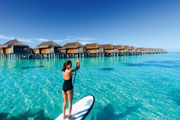 Paddle boarding at Constance Moofushi Maldives