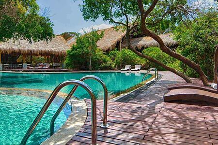 Pool amid jungle at Jungle Beach Sri Lanka