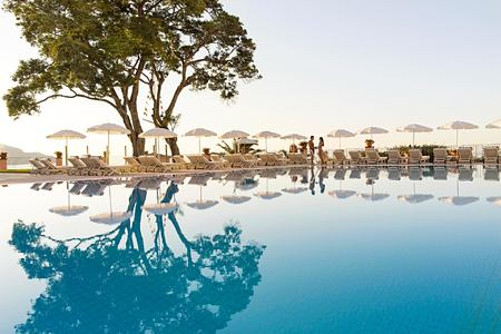 Pool and tree at Belmond Reids Palace Madeira Portugal