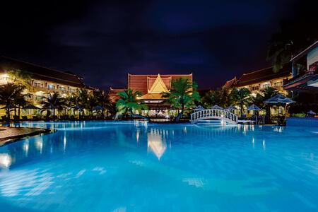 Pool area lit up at night at Sokha Beach Resort Cambodia