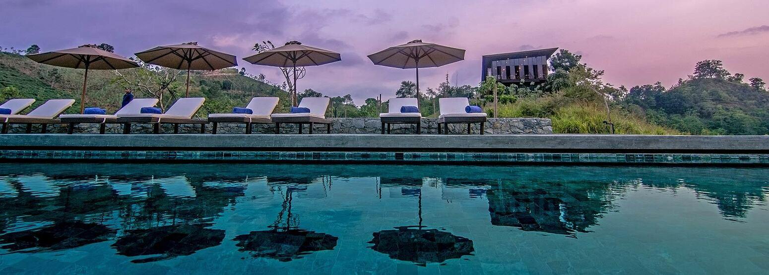 Pool with umbrellas at Santani Sri Lanka