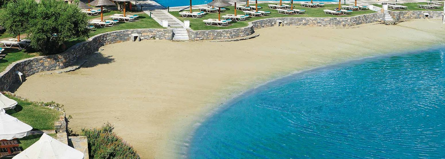 Sandy beach at Porto Elounda Golf and Spa Crete