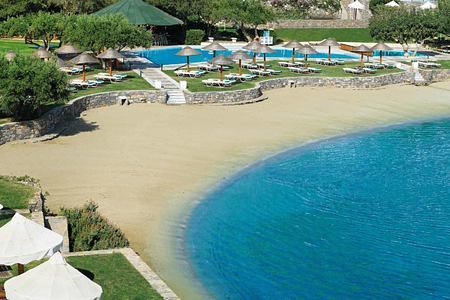 Sandy beach at Porto Elounda Golf and Spa Crete
