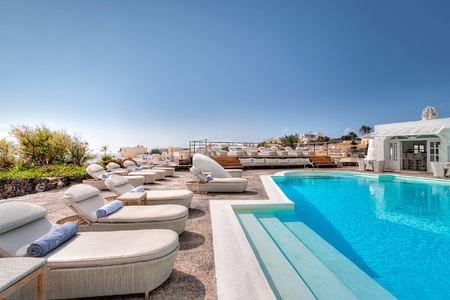 Sun beds by the pool at Vedema Santorini Greece