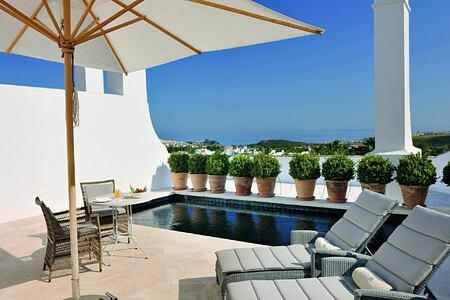 Sunbeds by pool at Finca Cortesin Spain