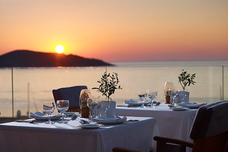 Sunset dining with a sea at Porto Elounda Golf and Spa Creteview