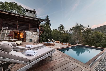 Terrace and pool at Ferme de Moudon France
