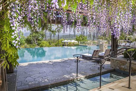 Wisteria blooms and pool at Terre Blanche Golf and Spa Resort France