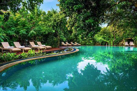 pool and chairs at Jungle Beach Sri Lanka